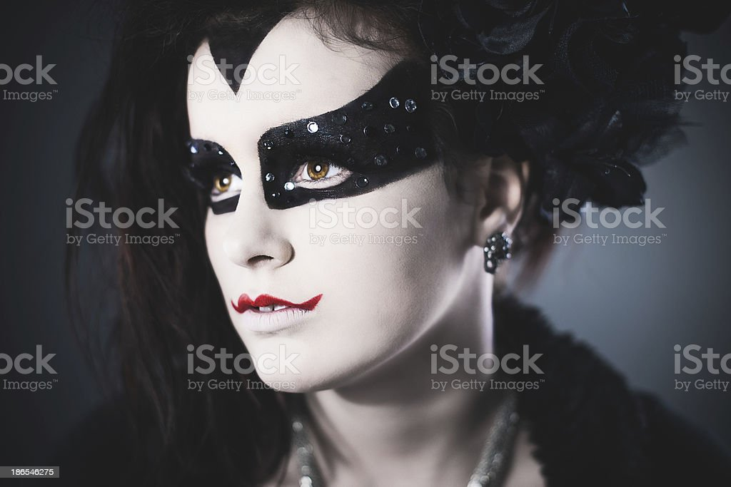 masquerade time girl dressed up as evil royalty-free stock photo
