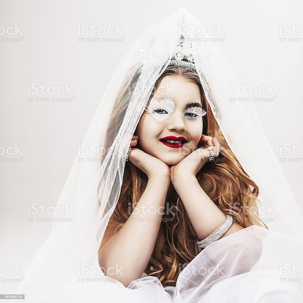 masquerade time girl dressed up as good queen stock photo