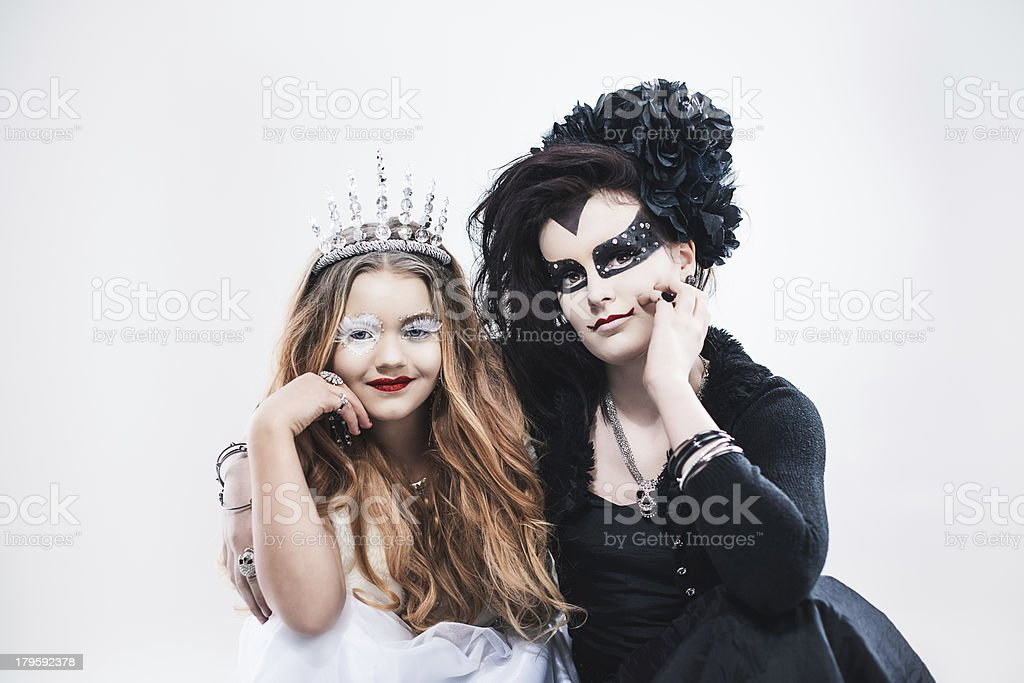 Masquerade time girls dressed up as good and evil royalty-free stock photo