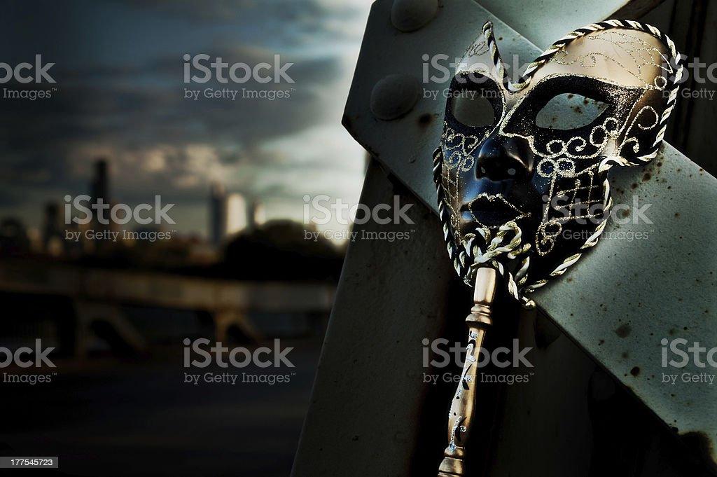 Masquerade - Venetian Mask on Vintage Bridge with City Skyline royalty-free stock photo