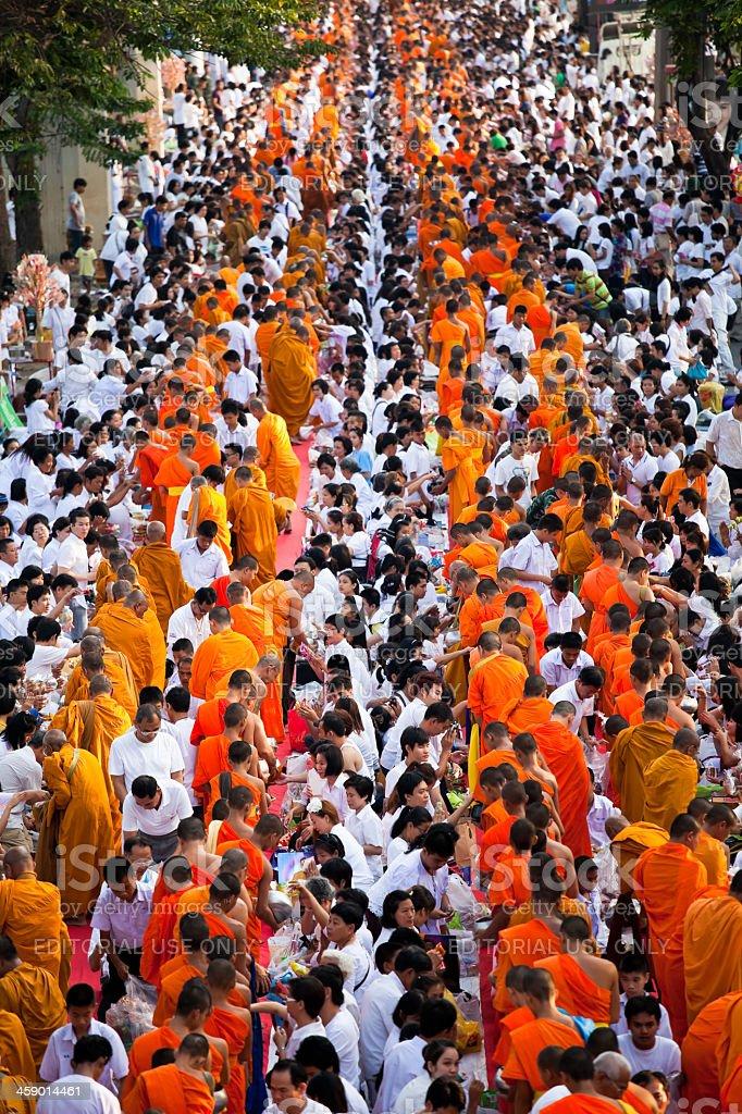 Mass Alms Giving in Bangkok royalty-free stock photo