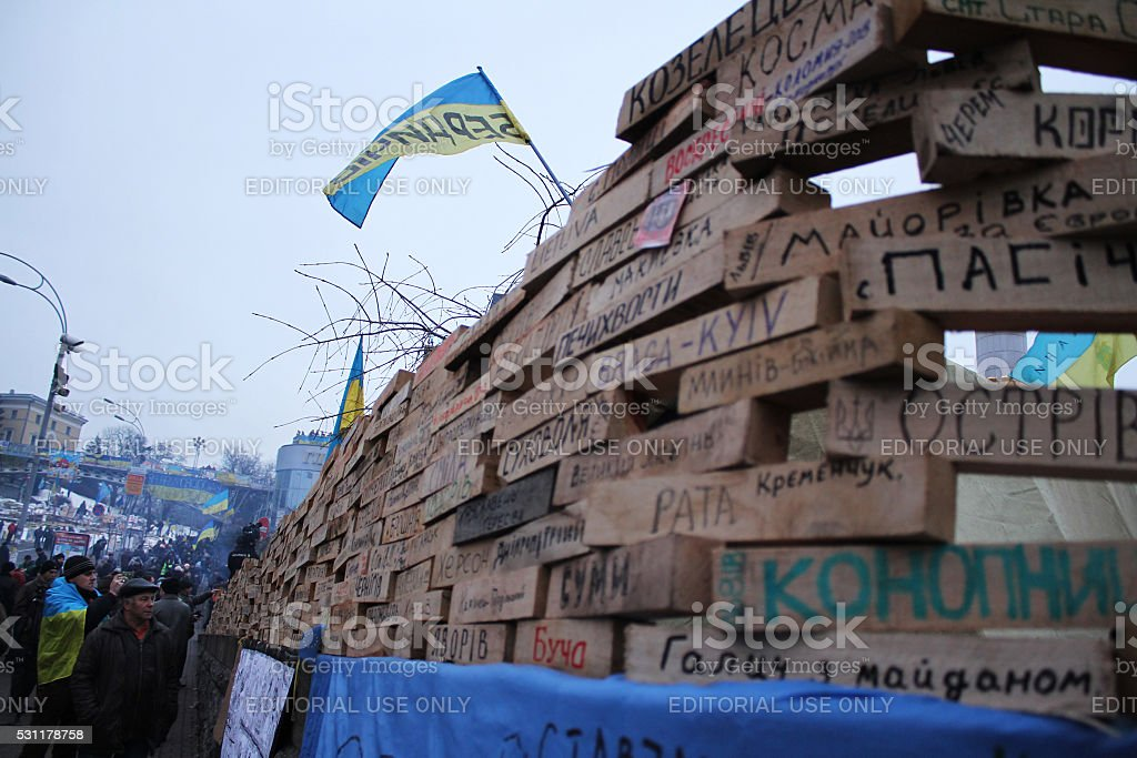 Mass anti-government protests 'EuroMaidan'. Nameplates hometowns protesters stock photo