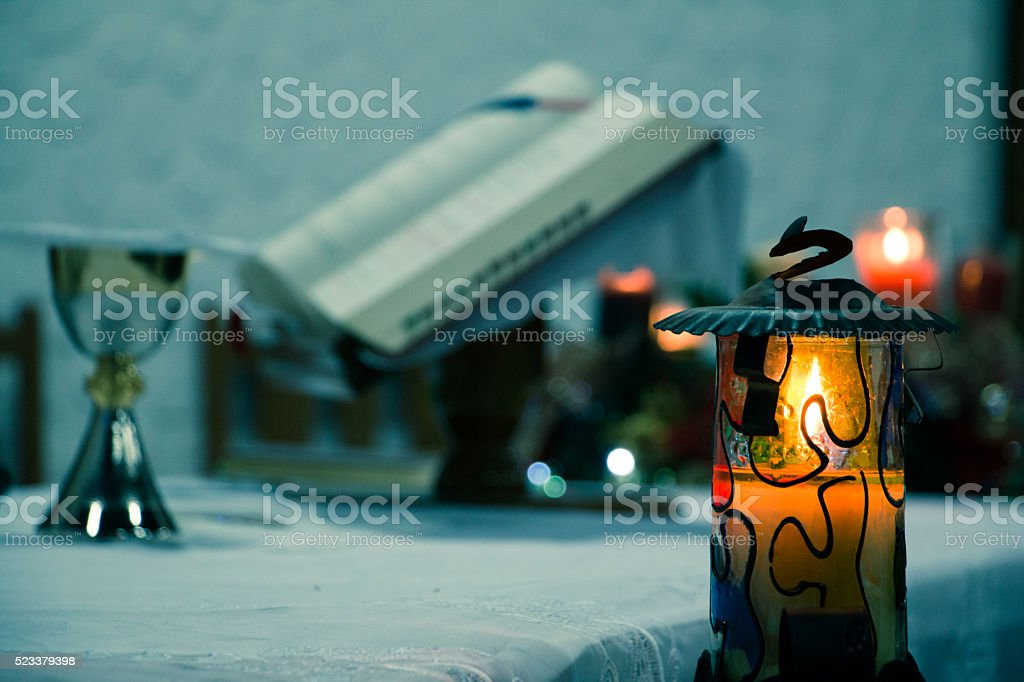 Mass, candle, bible and chalice of wine. stock photo