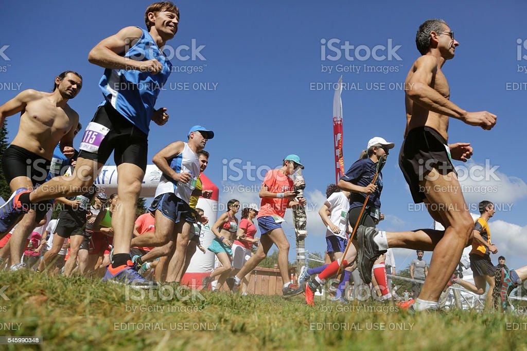 Mass marathon runners in the mountain stock photo