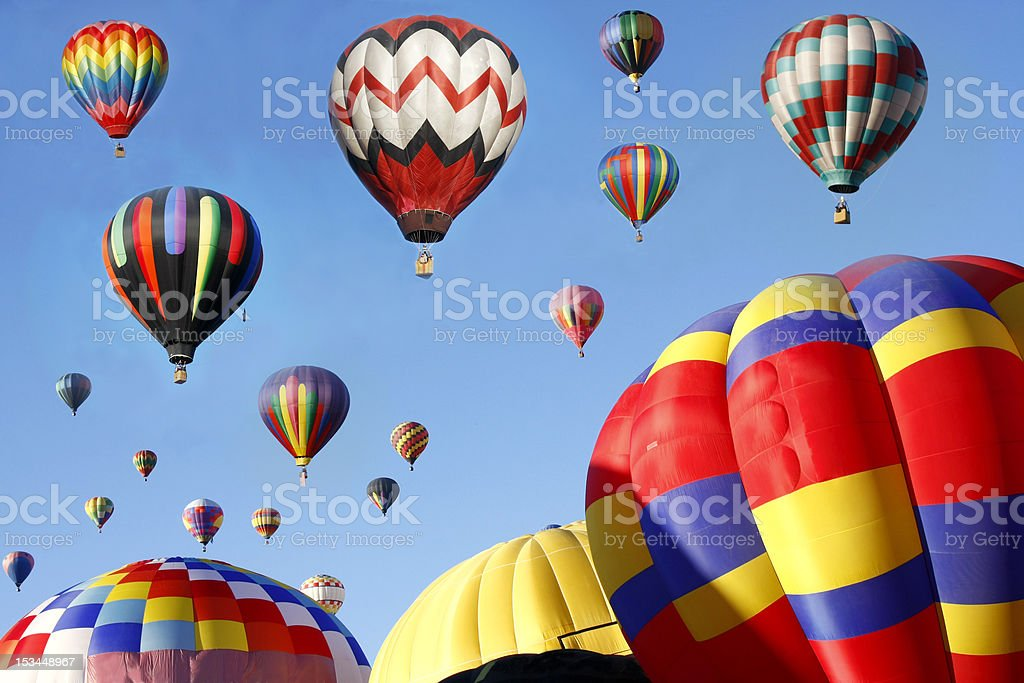 A mass of hot air balloons ascending into the sky royalty-free stock photo