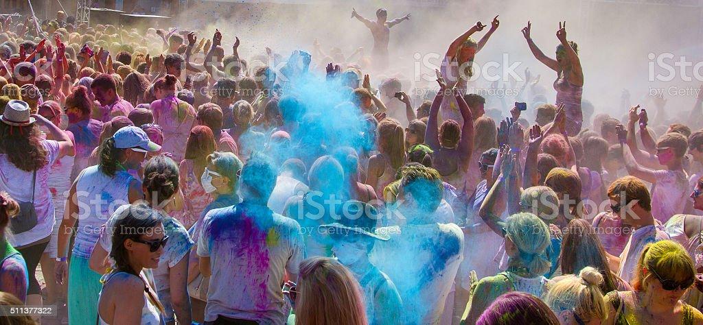 Mass of people celebrating Holi festival stock photo