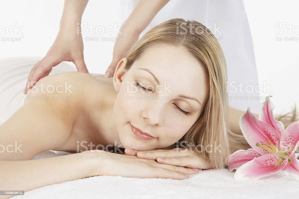Massage a young woman royalty-free stock photo
