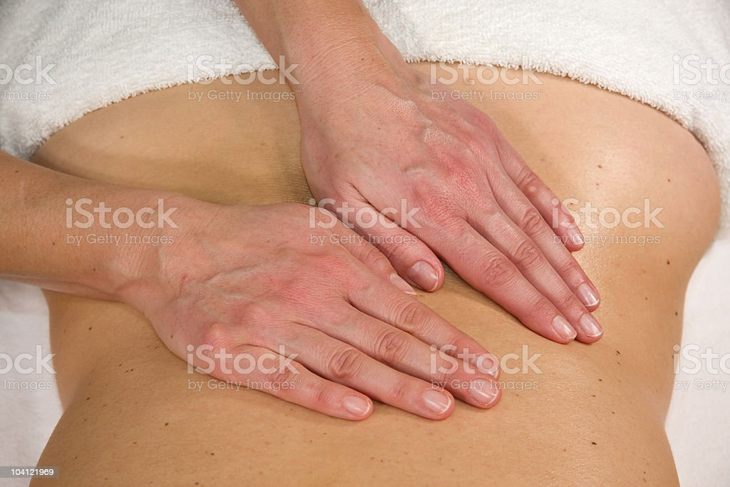 massage at lumbar region stock photo