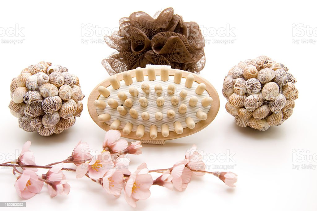 Massage brush with sponge and mussel sphere royalty-free stock photo