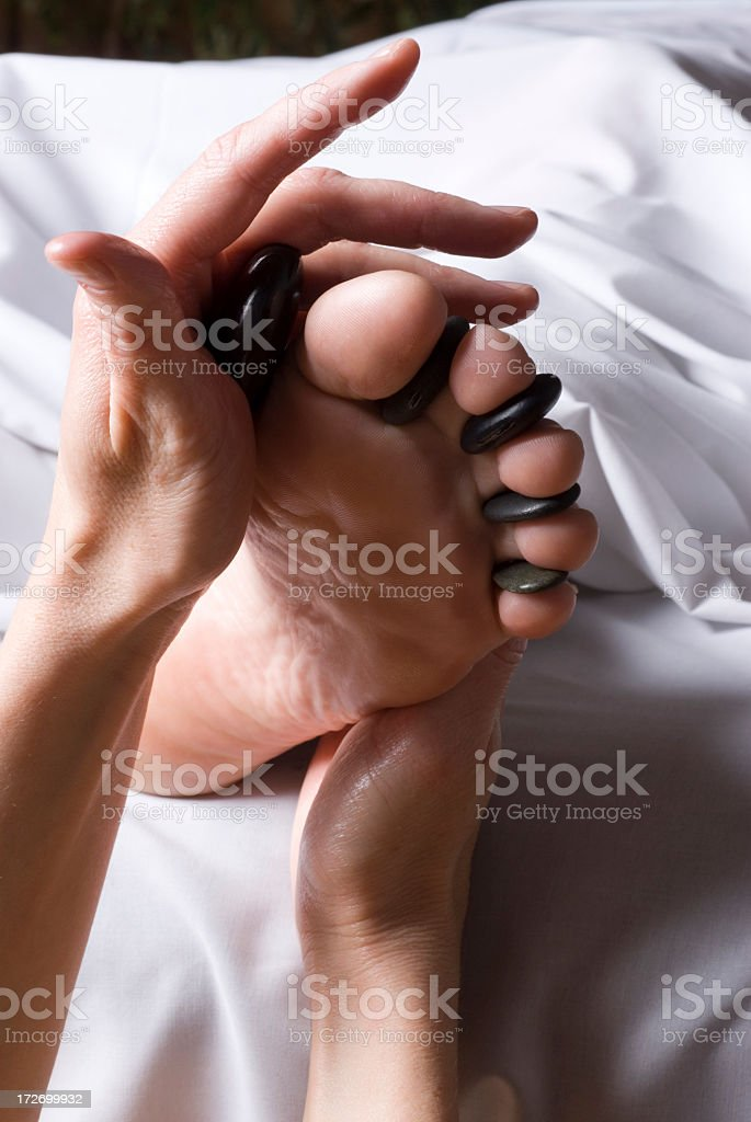 A massage directed towards foot reflexes royalty-free stock photo