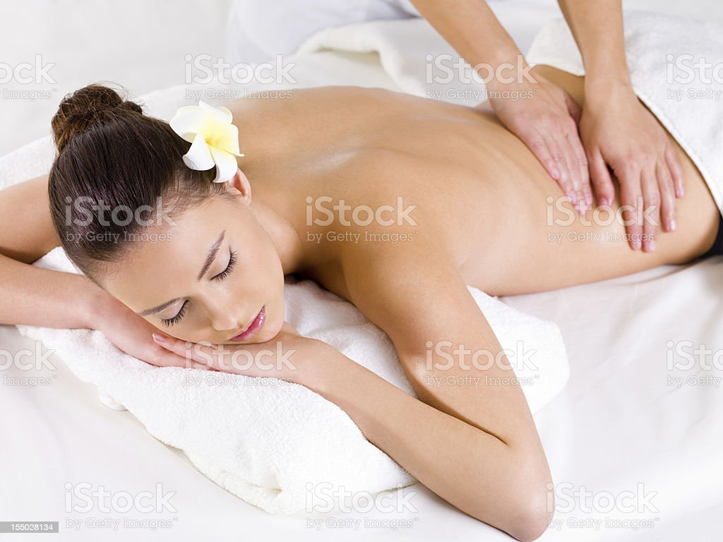 Massage for the back of woman in spa salon royalty-free stock photo