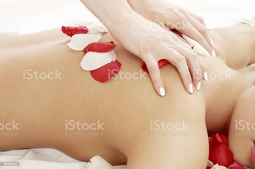 massage hands and rose petals royalty-free stock photo