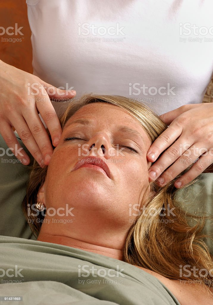Massage Head and Face at Wellness Center royalty-free stock photo