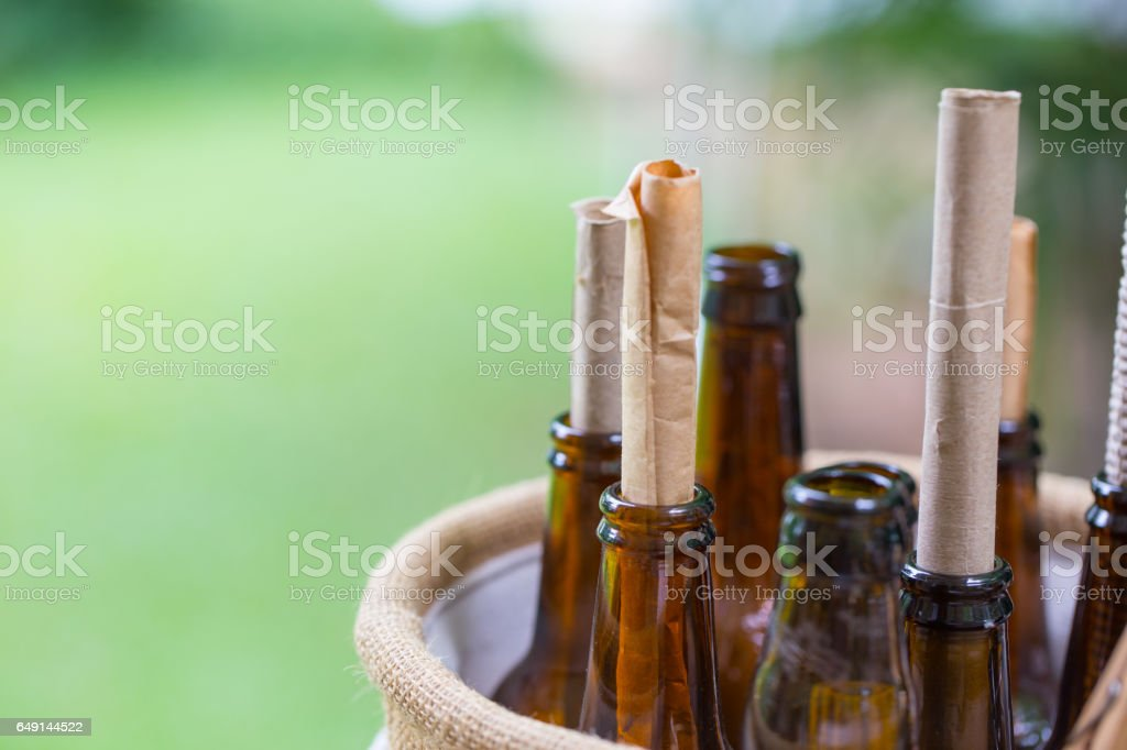 massage in the bottle, roll of letter paper in the glass bottle home decoration. stock photo