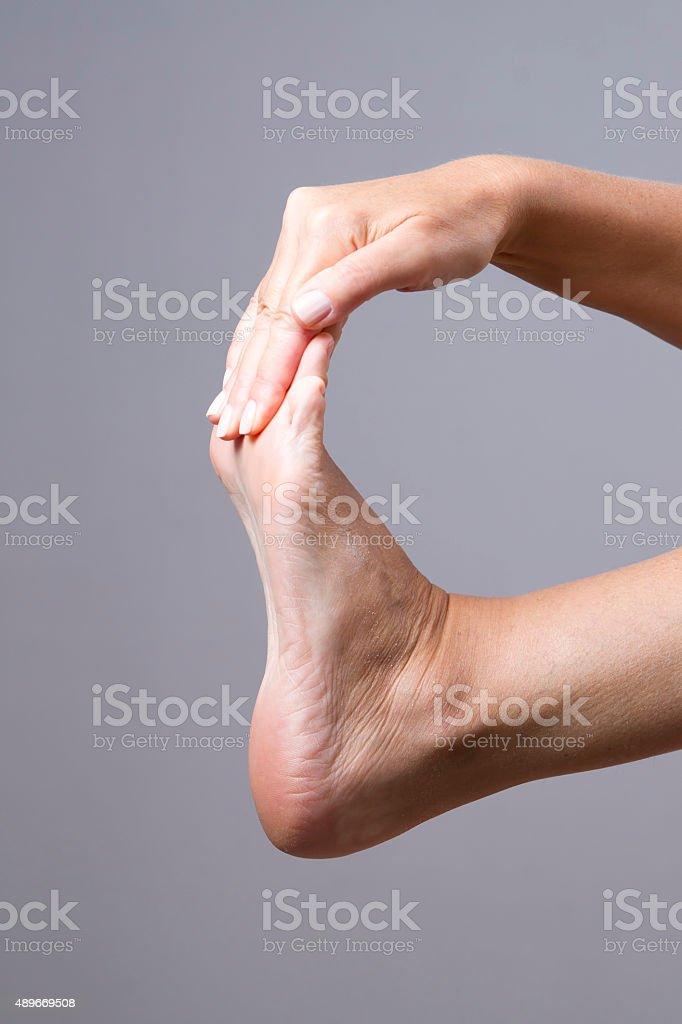 Massage of female feet stock photo