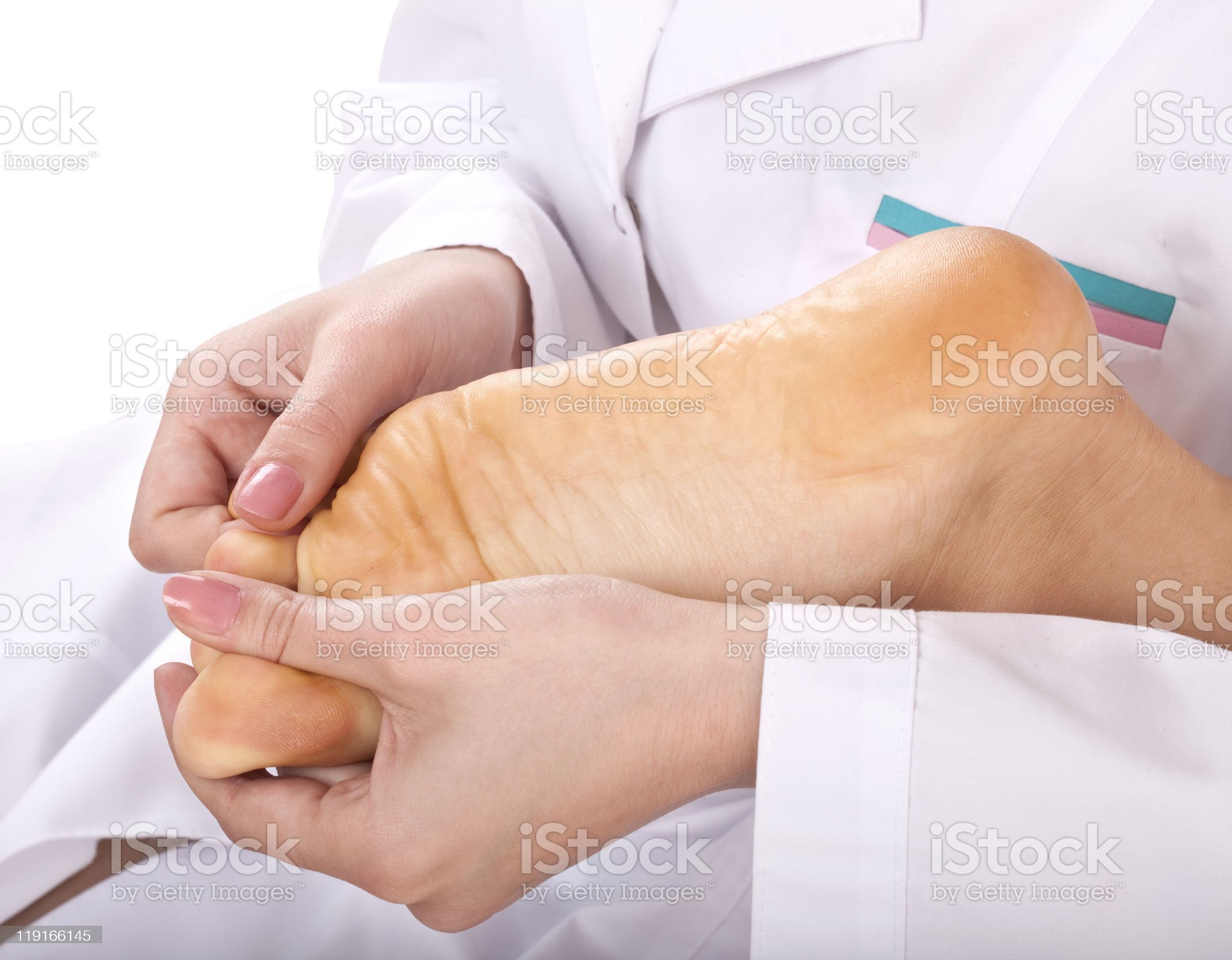 Massage of female foot. royalty-free stock photo