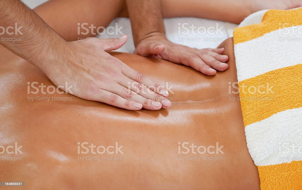 Massage of lumbosacral area royalty-free stock photo