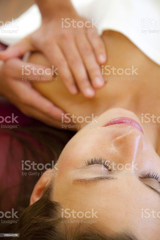 Massage of shoulder with focus on face royalty-free stock photo