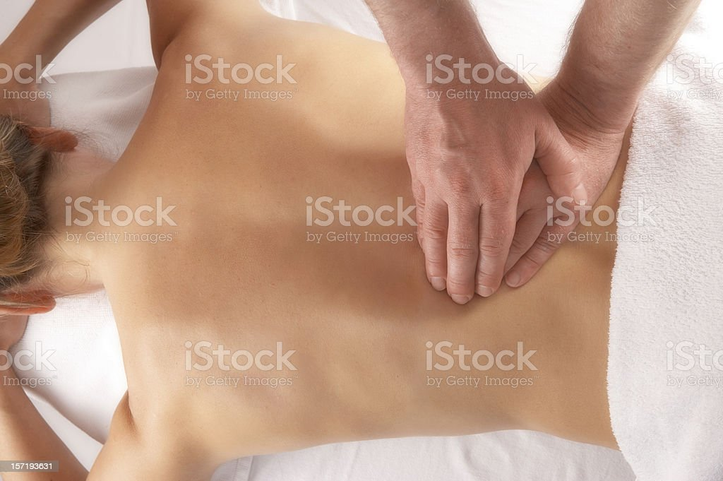 massage of the lower back stock photo
