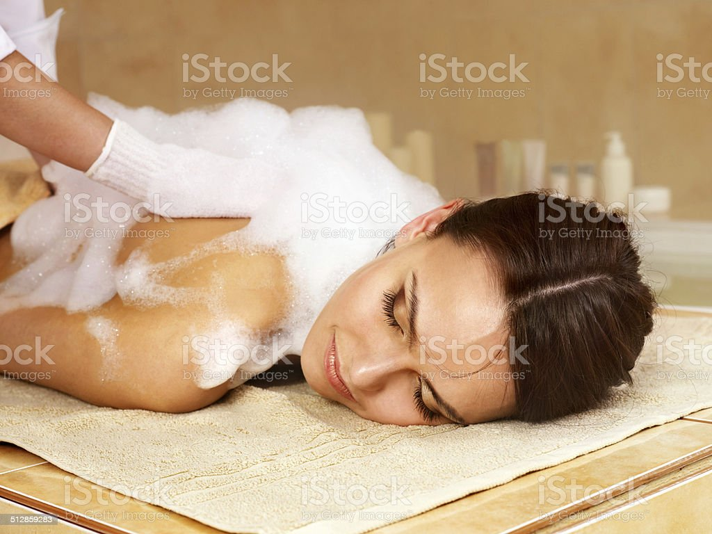 Massage of woman in beauty spa. stock photo