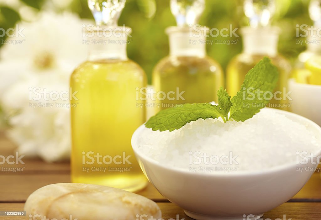 Massage oil and exfoliation bottles at spa stock photo