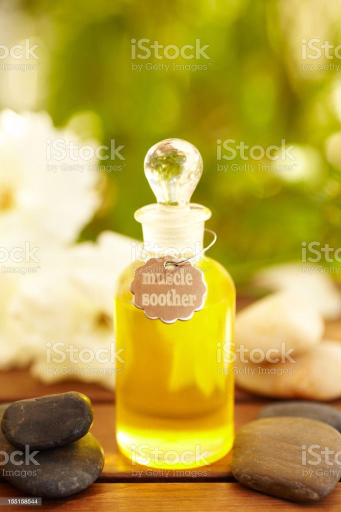 Massage oil bottle with 'Muscle Soother' written on it stock photo