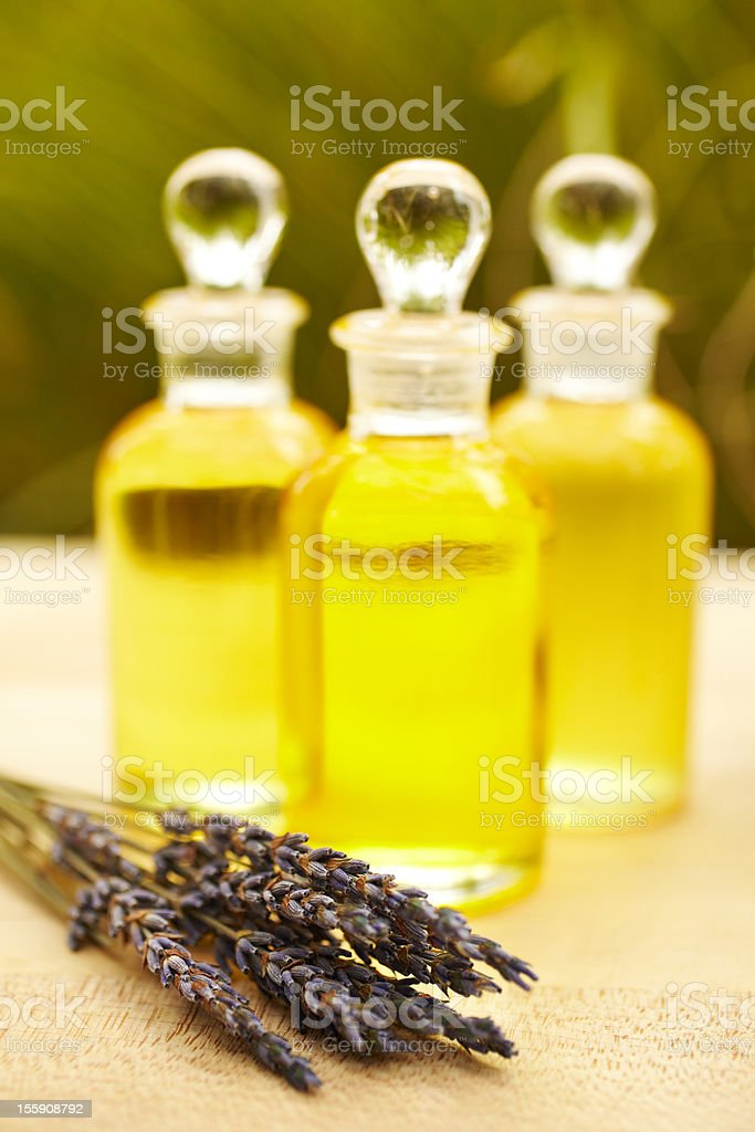 Massage oil bottles at spa with lavender royalty-free stock photo