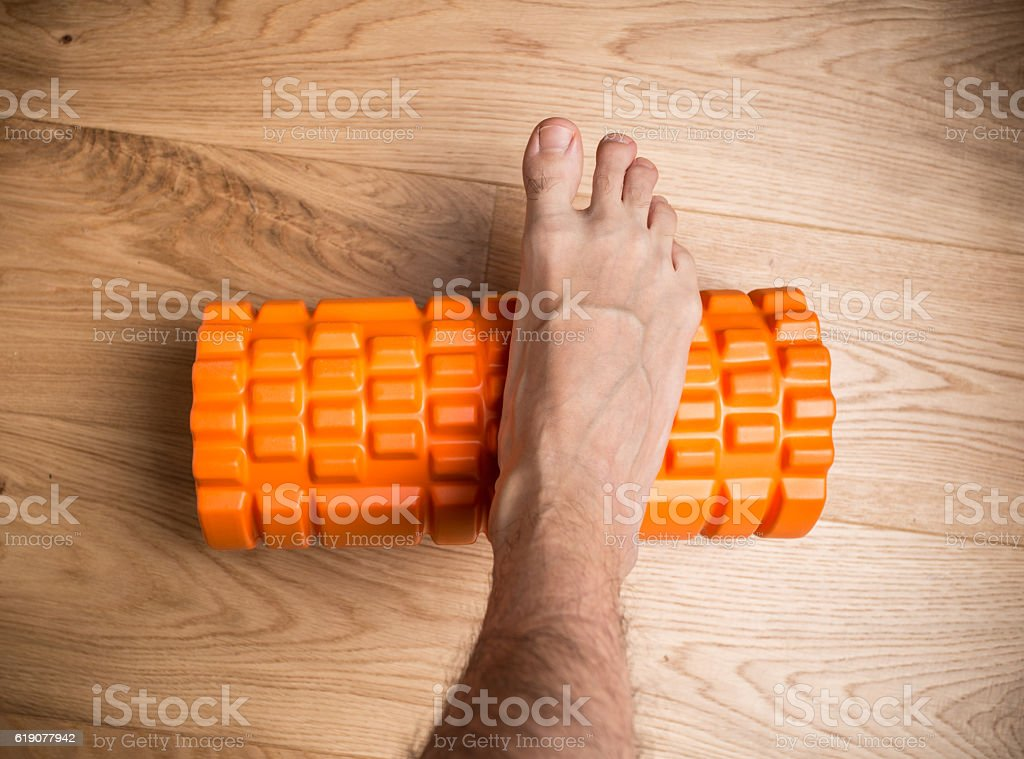 Massage roller tool used for feet stock photo