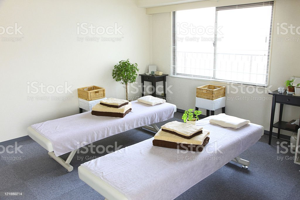 Massage salon with two prepped tables stock photo