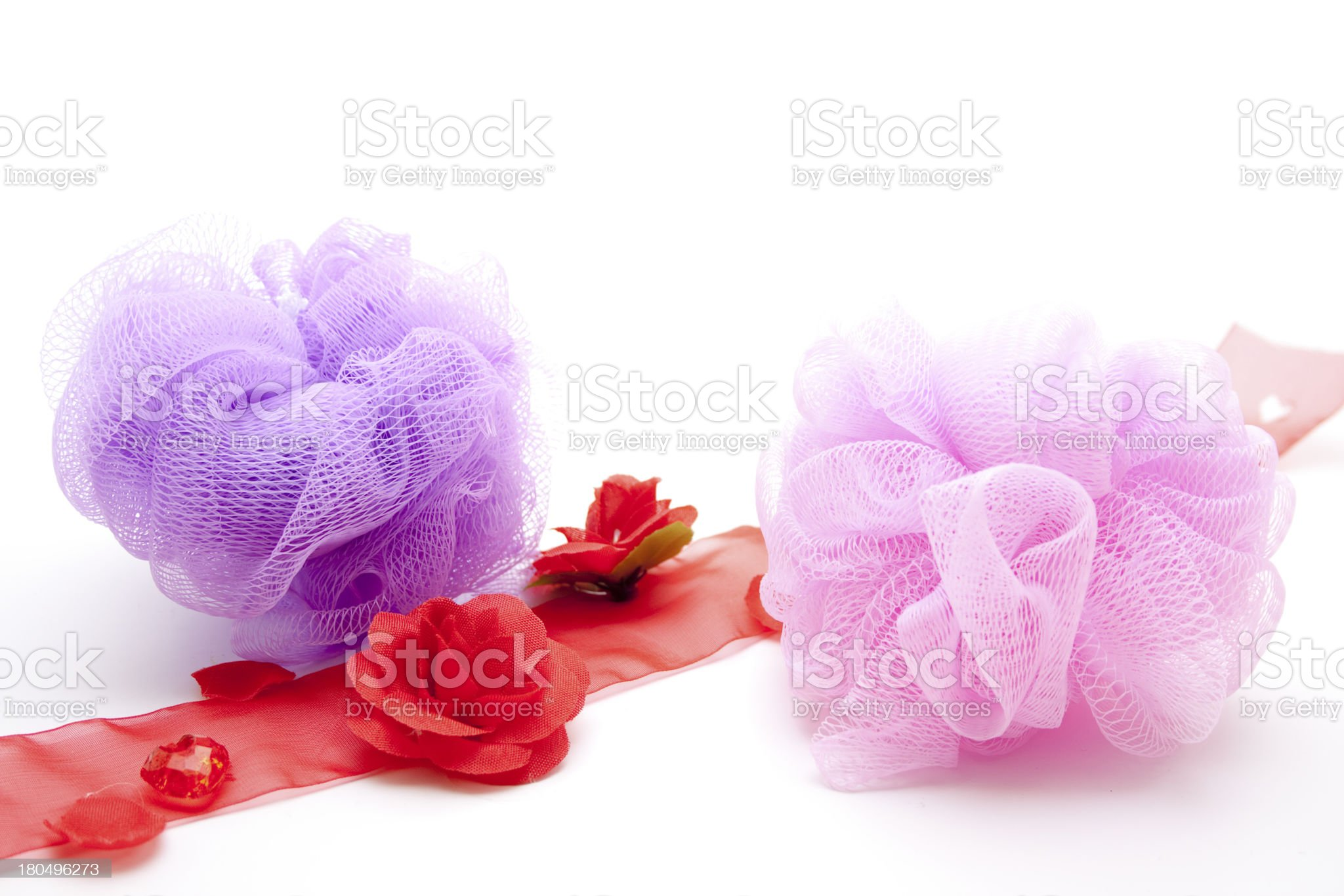 Massage sponge and red rose loop royalty-free stock photo