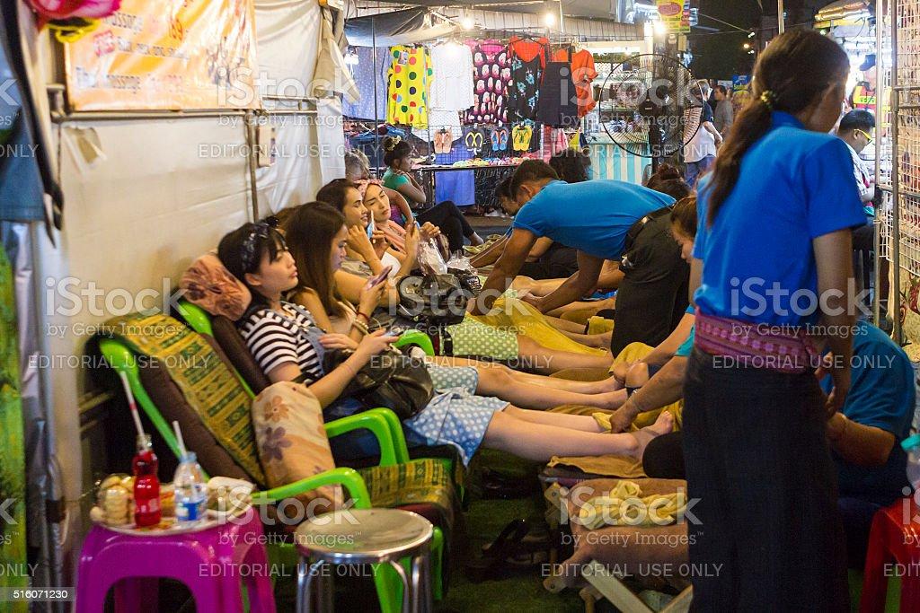 Massage stall in Hua Hin night market, Thailand stock photo