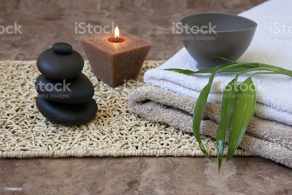 massage stones, bamboo and candle stock photo
