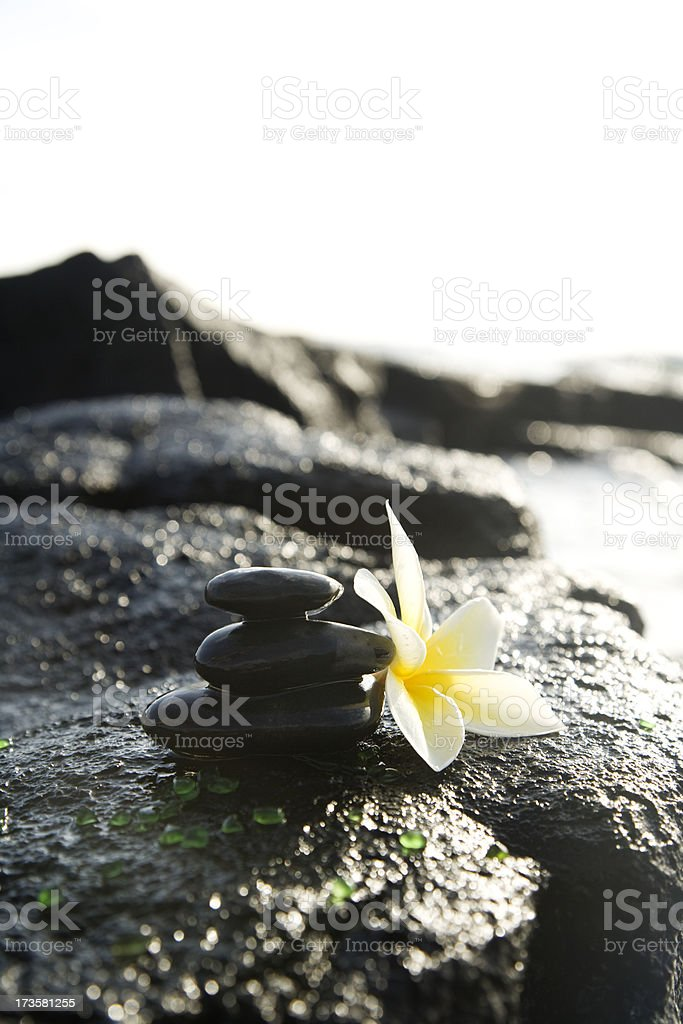 Massage Stones Stacked on Volcanic Rock royalty-free stock photo