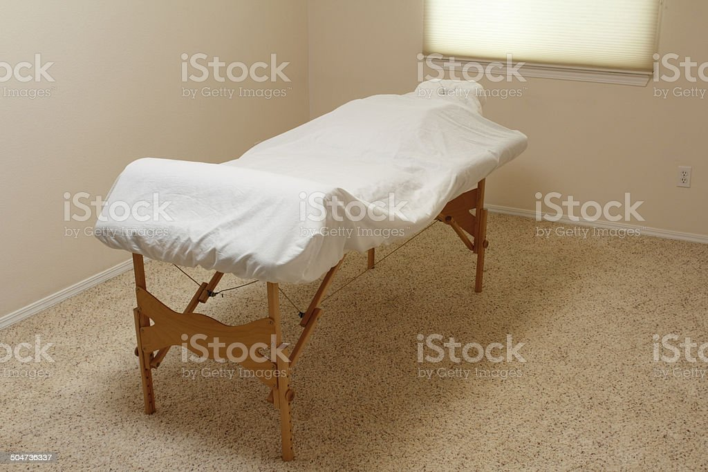 Massage Table in a Treatment Room stock photo