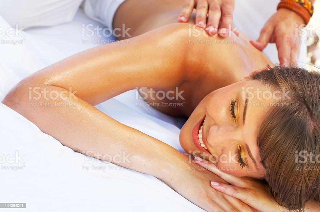 Massage therapist massaging a young woman royalty-free stock photo