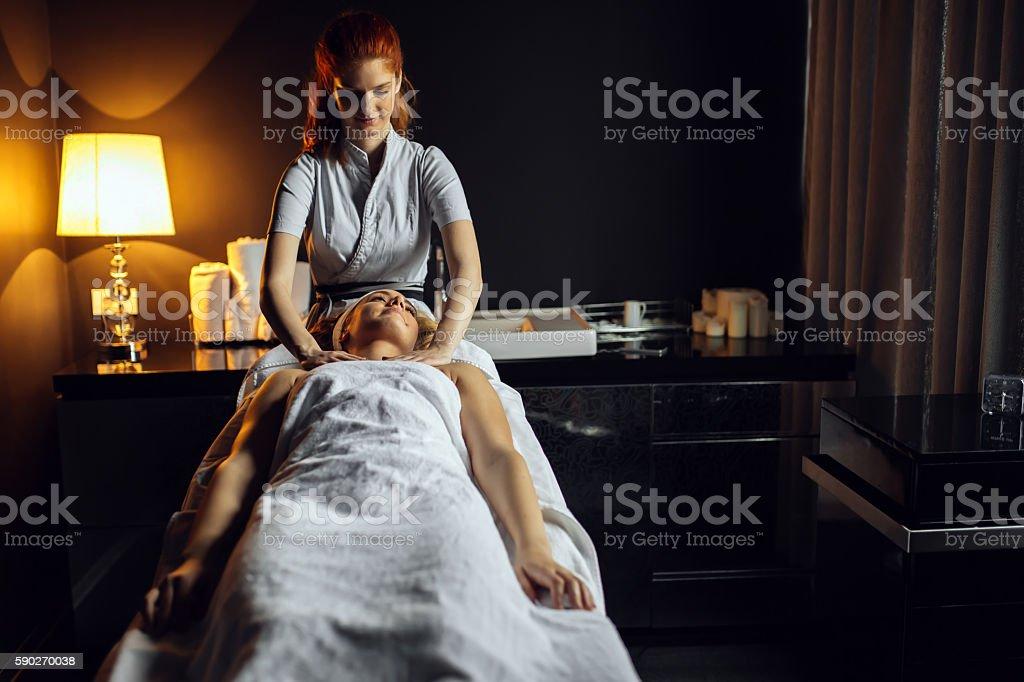 Massage therapist massaging woman stock photo