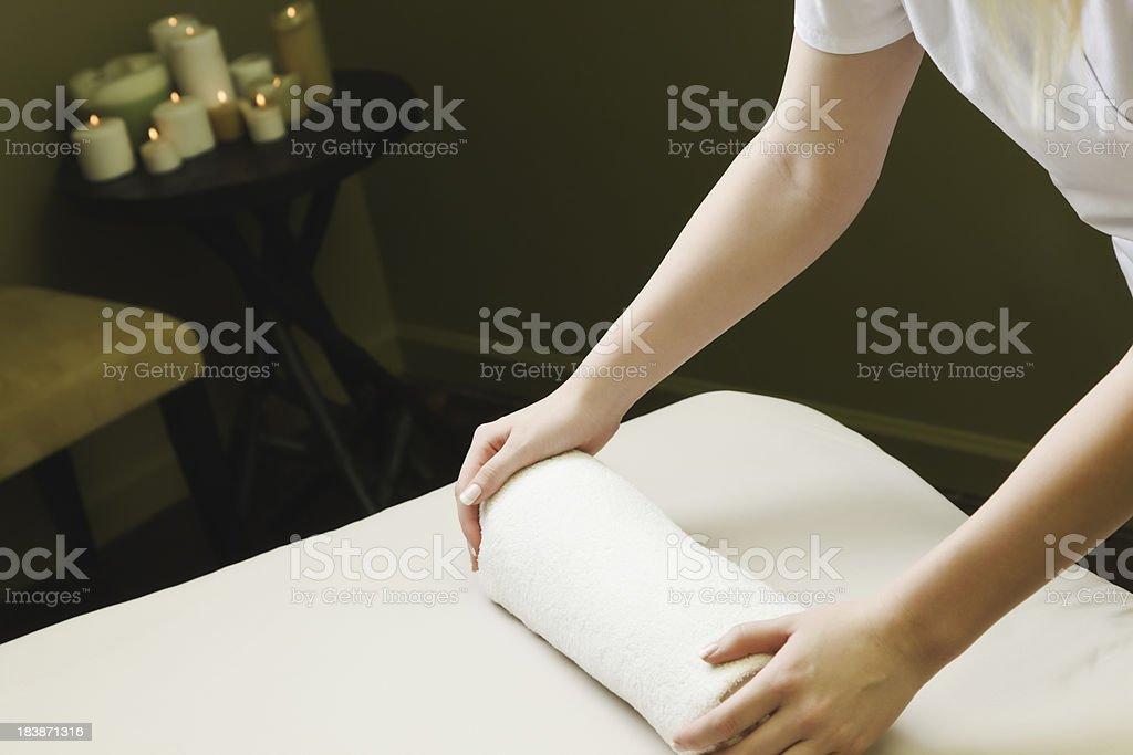 Massage Therapist Prepares Treatment Room stock photo
