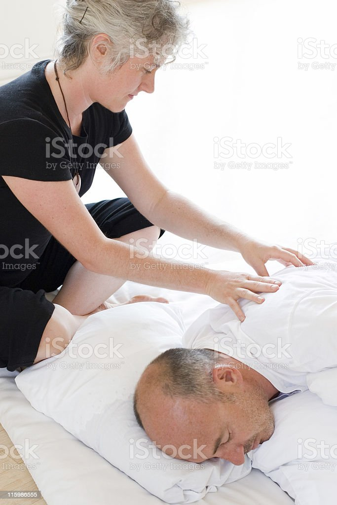 Massage Therapist Working on Pressure Points royalty-free stock photo