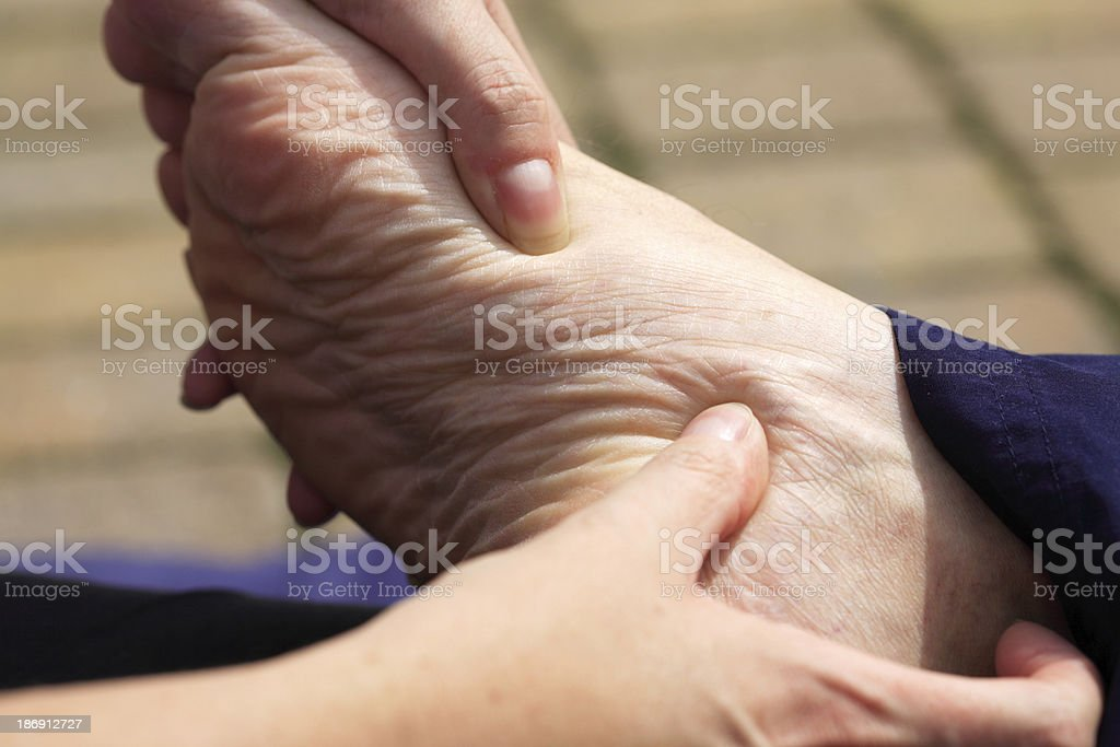 Massage to the foot royalty-free stock photo