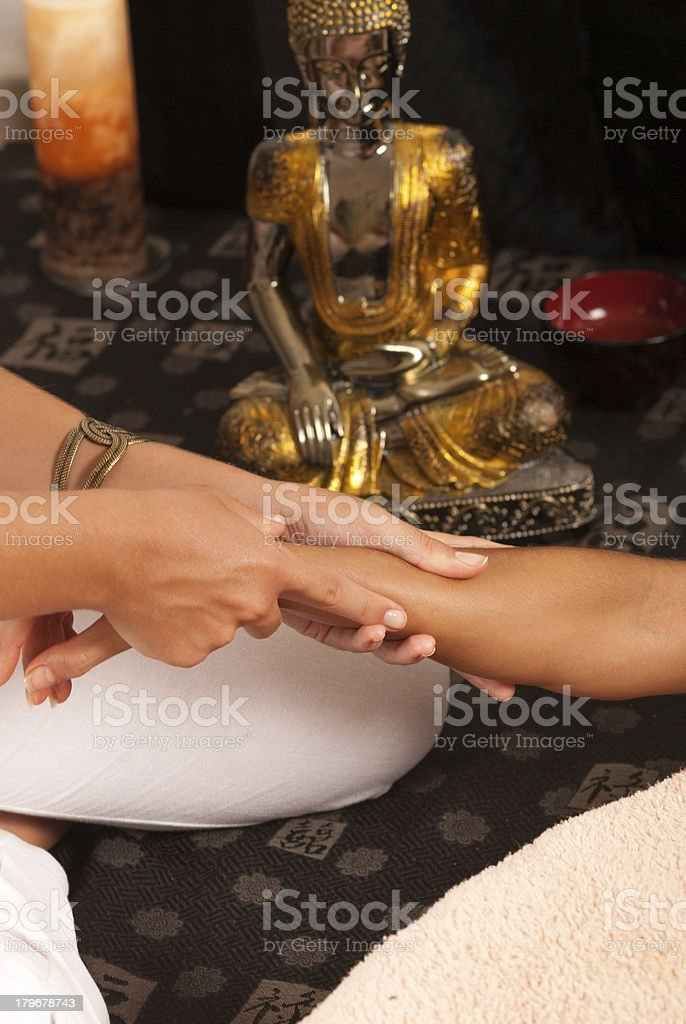 Massaging an arm royalty-free stock photo