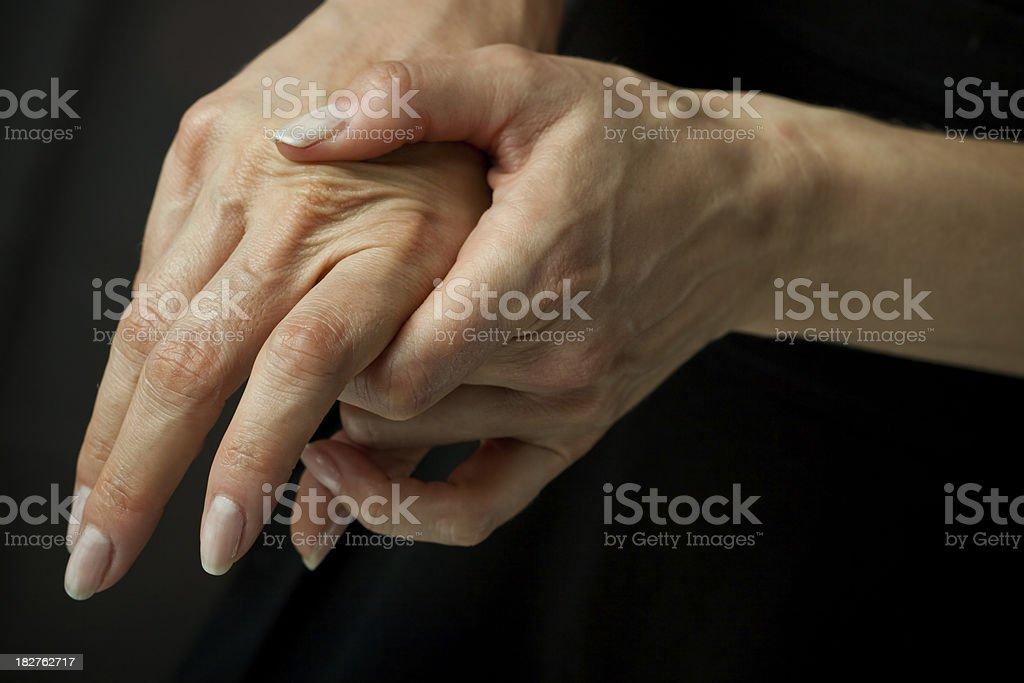 Massaging arthritic hands stock photo