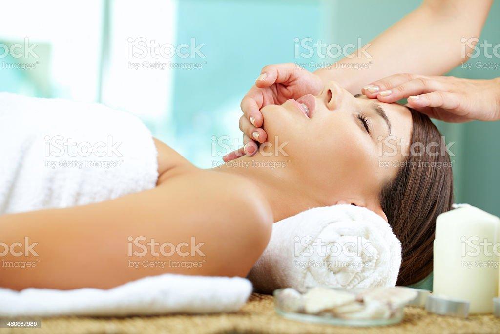 Massaging face stock photo