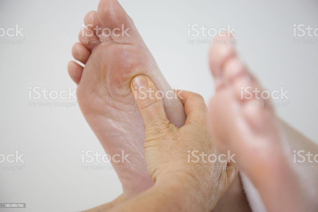massaging feet royalty-free stock photo