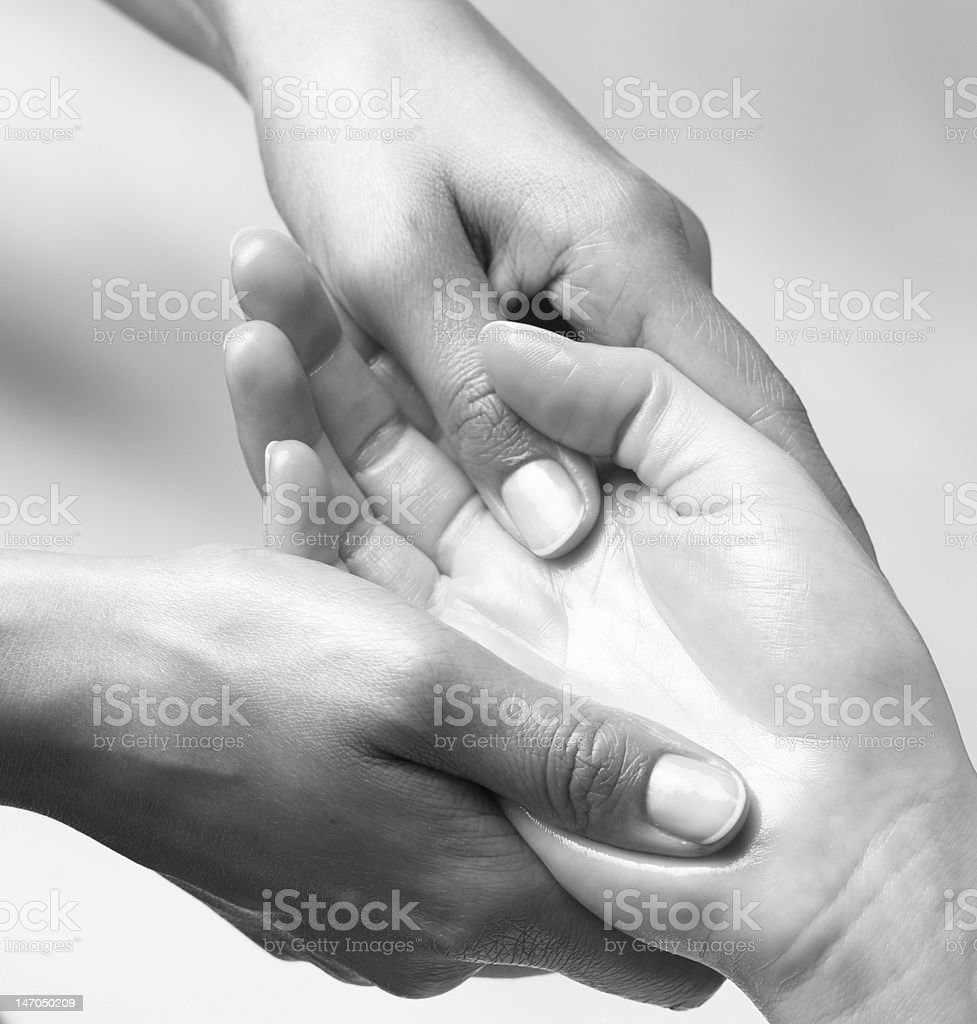 massaging hand royalty-free stock photo