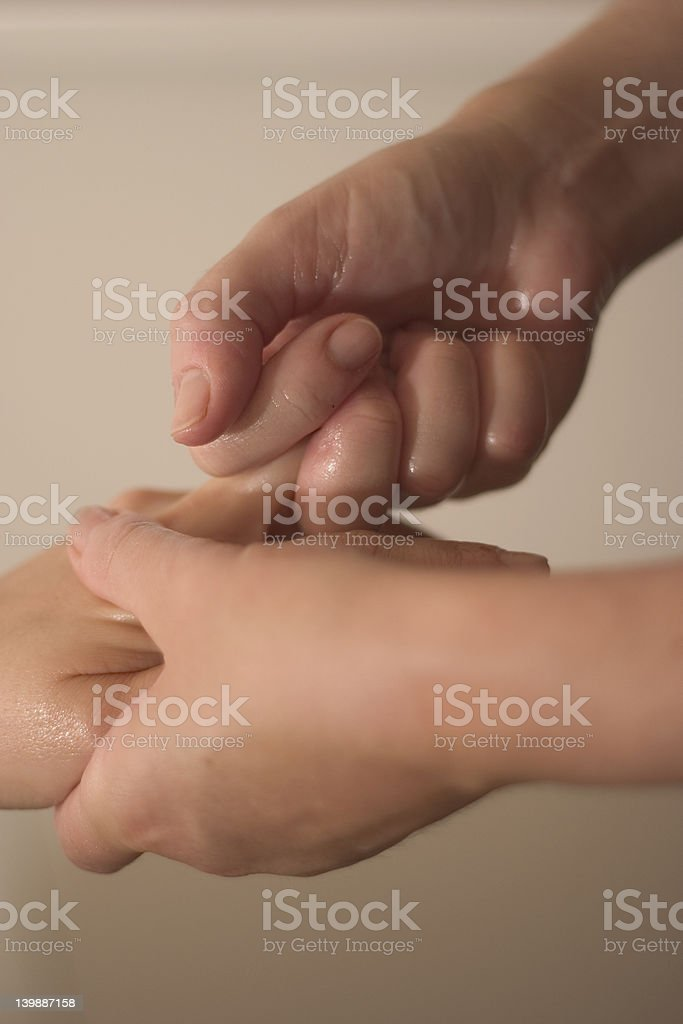 massaging hands stock photo