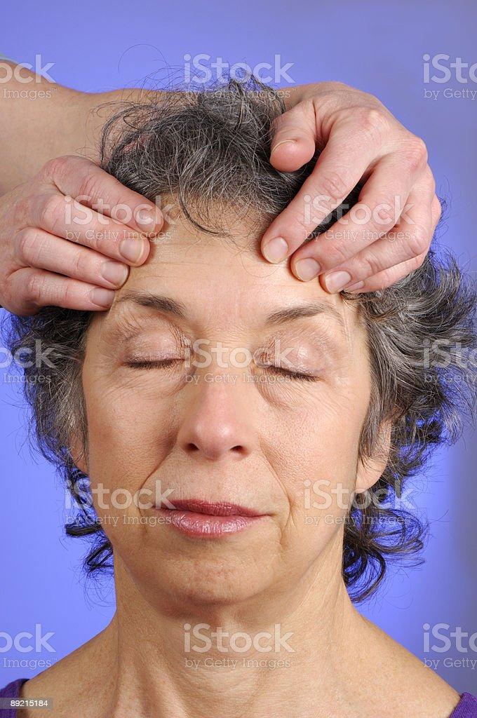 Massaging Head of Senior Woman at Spa royalty-free stock photo