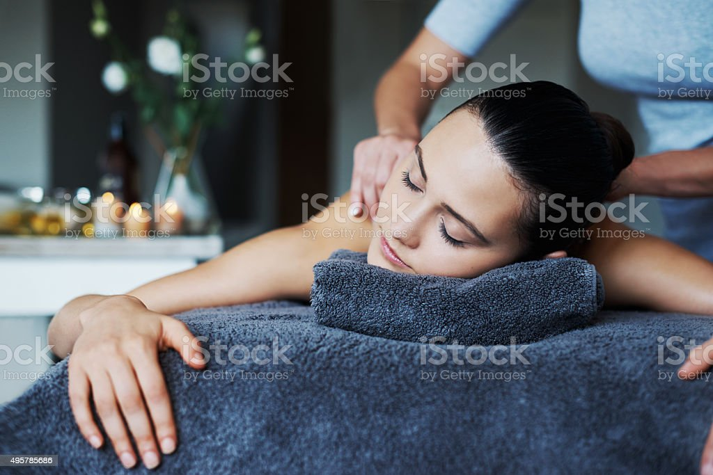 Massaging new life into her skin stock photo