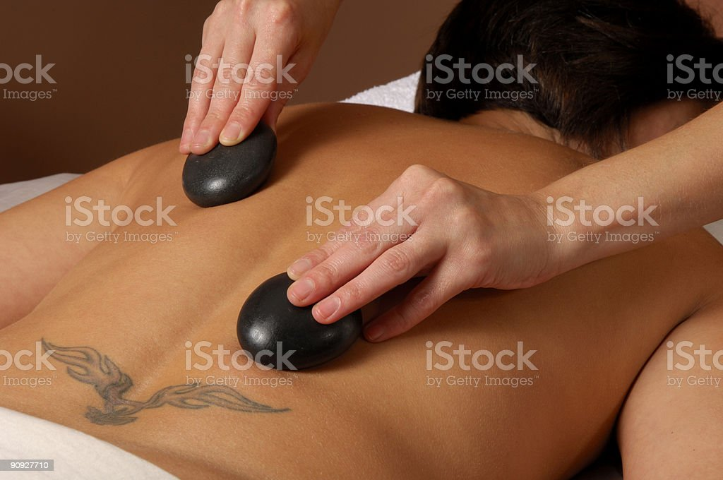 Massaging with Hot Mineral Stones at Spa royalty-free stock photo