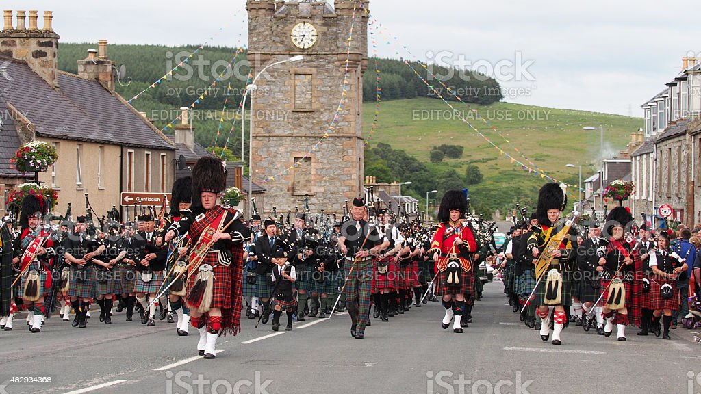 Massed Pipe Bands marching in Dufftown, Scotland. stock photo