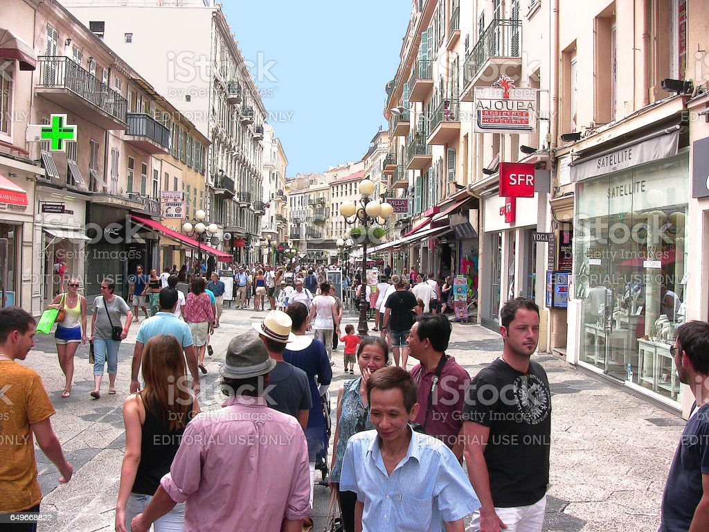 Massena street coming from the namesake square on a summer's day with sun. This photo was taken in the city of Nice, on a sightseeing tour stock photo